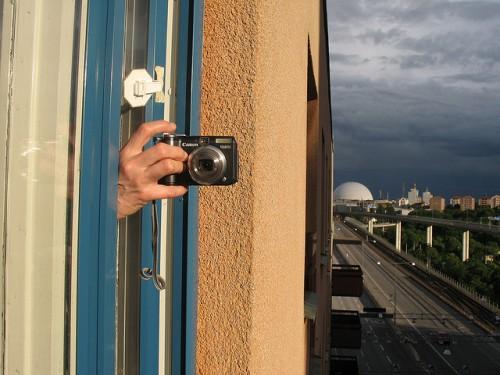 globen och kamerahanden